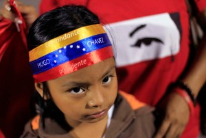 Young supporter of Venezuela's President Chavez stands at a square in San Salvador